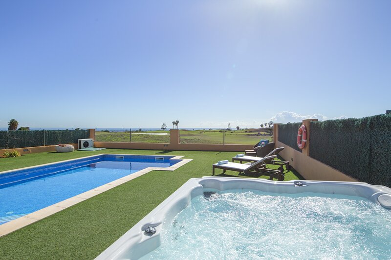Exclusive Family Villa. Spa, Ocean-View. Fenced Heated Pool, Playground, Cabana, holiday rental in Caleta de Fuste