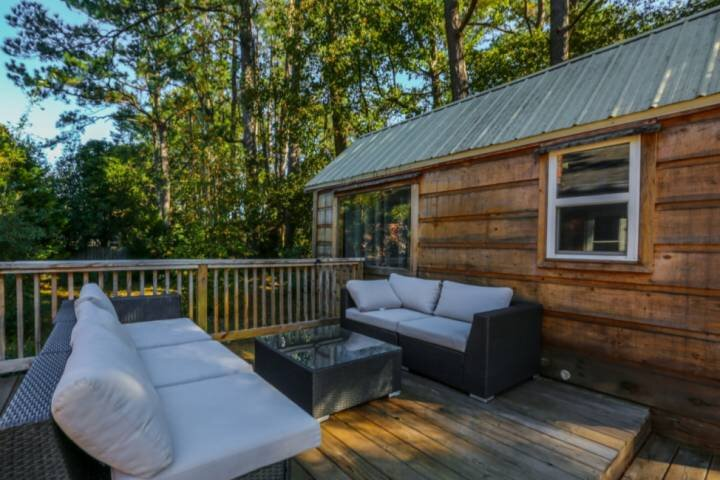 Sip your morning coffee on the wooden deck in the backyard of the house.