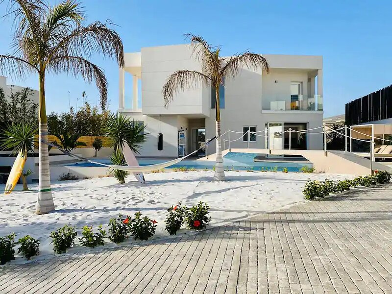 Contempory Villa, large swimming pool with private sandy beach, holiday rental in Armenime