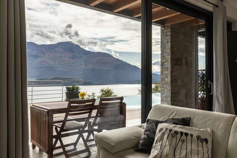 Appartamento Family in residence con piscina, location de vacances à Trezzone