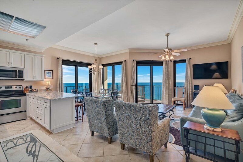 Open Plan Living Area with floor to ceiling windows, a queen size sleeper sofa overlooking the Gulf of Mexico