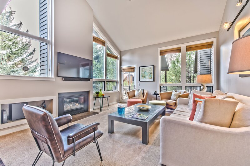 Living Room with Comfortable Furnishings, Vizio Smart TV and Sony Sound Bar, Gas Fireplace, and Private Deck