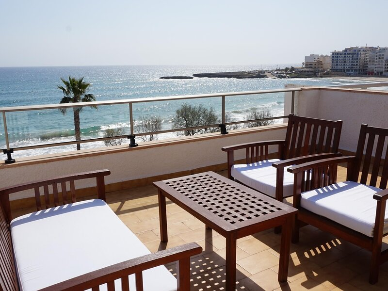 Apartment with terrace by the beach with sea view - Antic 301, location de vacances à S'illot