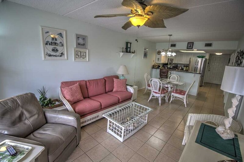 Furniture,Chair,Couch,Indoors,Ceiling Fan