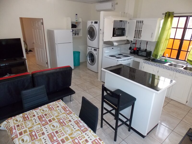 Stewart Hotel Apt -Trincity,Airport,Washer,Dryer,WiFi,Netflix,Office,Gated,Alarm, holiday rental in Arouca