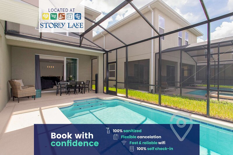 Enclosed back patio with a private pool, outdoor dining and sun lounging space.