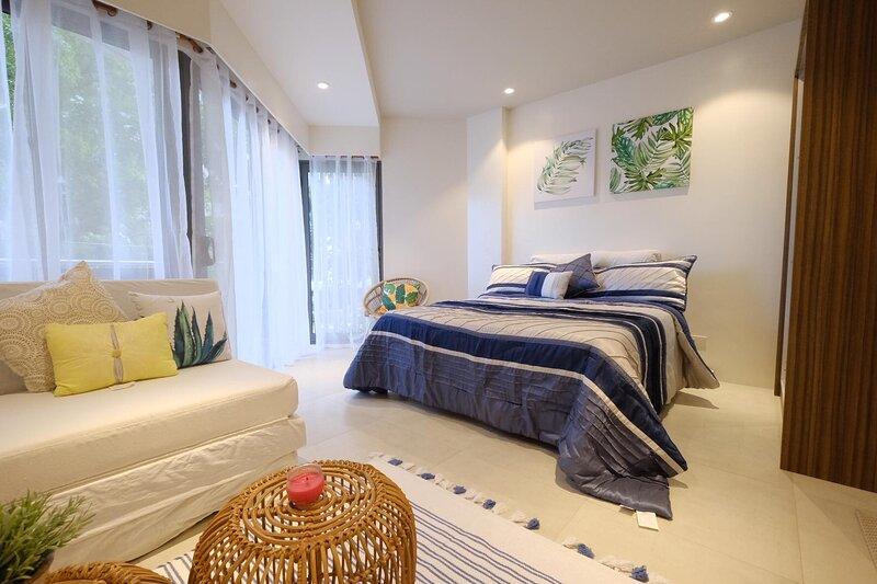 Bldg.2, Unit 2J, Tambuli Seaside Resort, location de vacances à Cordova