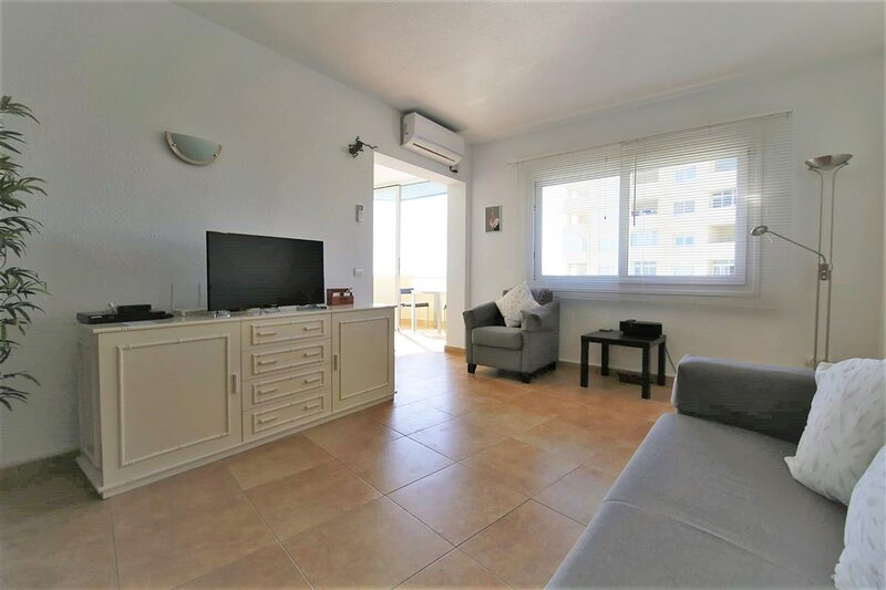 Bright and spacious lounge with air conditioning and international TV