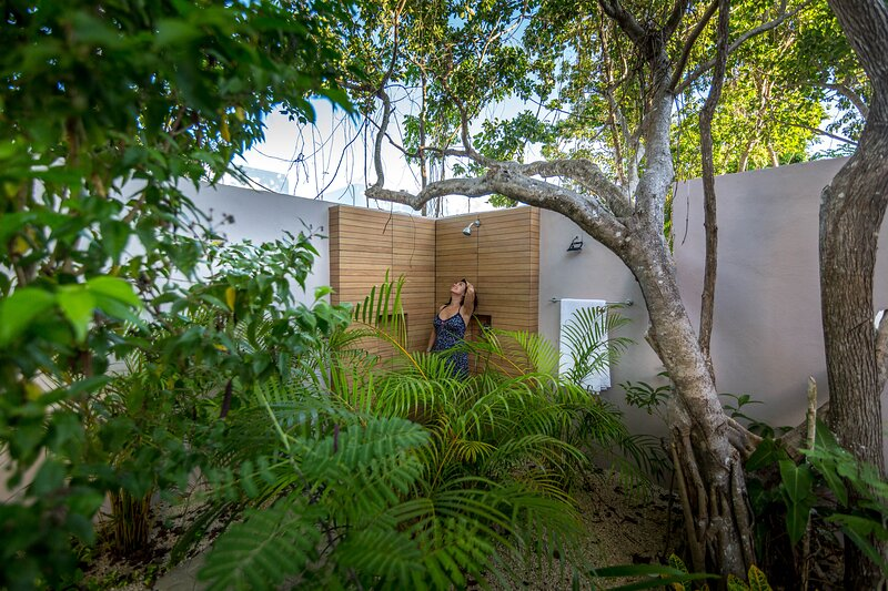 Casa Pakal features a fabulous backyard/patio with outdoor shower, hammocks, grill and dining area