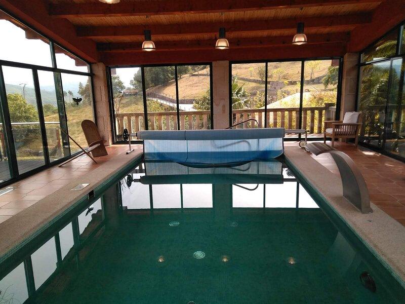 Casa con piscina climatizada en plena naturaleza, vacation rental in Ricovanca