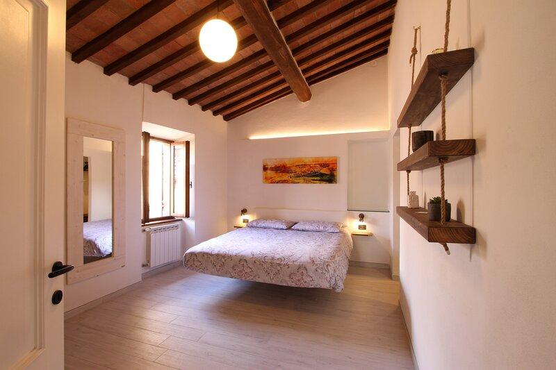 Appartamento di charme in Val d'Orcia, vacation rental in Monticchiello