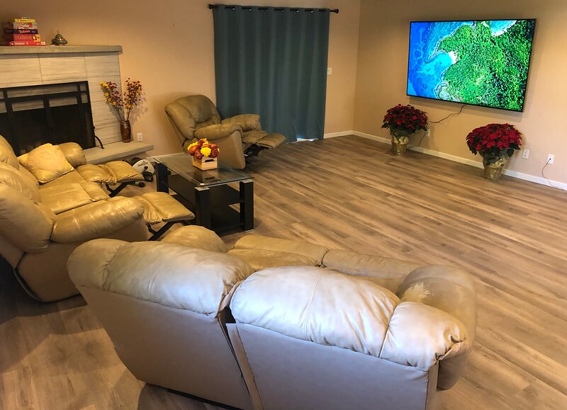 Home theater system with 86' TV including Disney+, Hulu, Netflix. Just relax on the reclining sofas