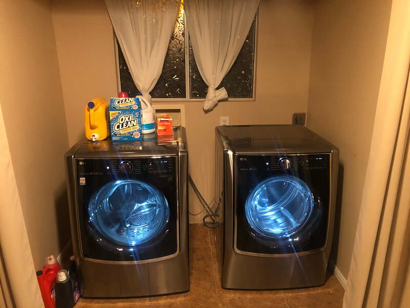 LG washer and dryer, with detergents available at no extra cost