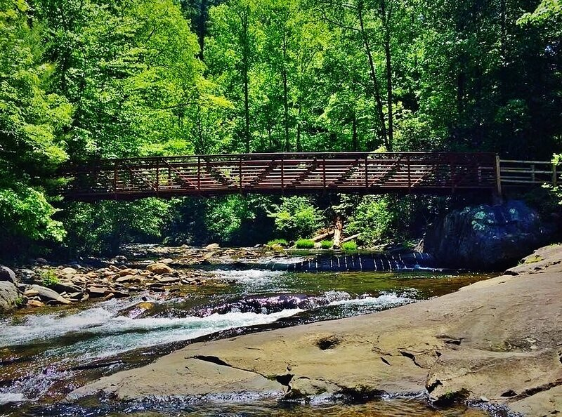 Fires Creek bridge near Leatherwood Falls, leads to a 29 mile hiking loop, or fishing spots to try.