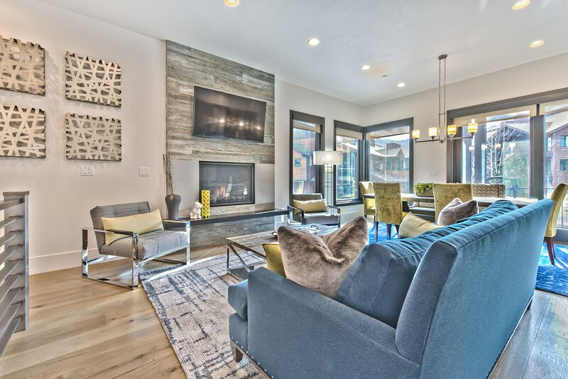 New Comfortable Mountain Contemporary Furnishings Surround a Warm Gas Fireplace and Large Flat Screen TV