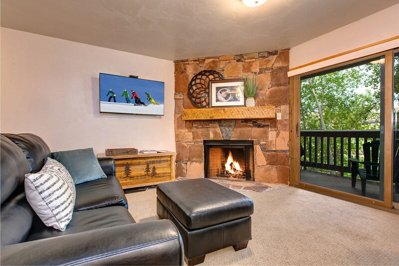 Cozy Gas Fireplace  and a Smart TV