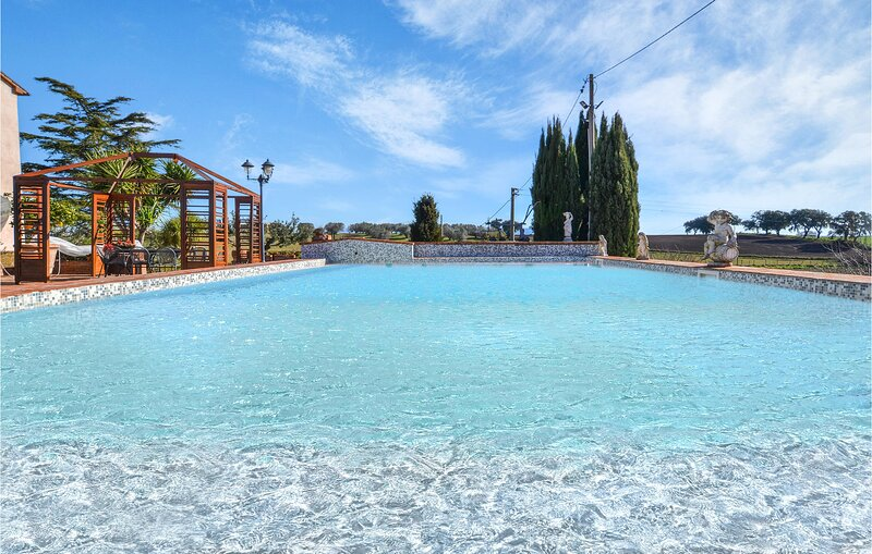Amazing home in Tuscania with Outdoor swimming pool, Sauna and WiFi (IRU390), vacation rental in Tuscania