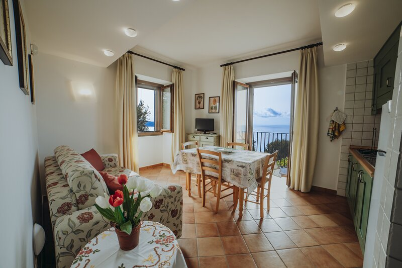 Bilocale 2 - Residenza Golfo Degli Ulivi, location de vacances à San Nicola