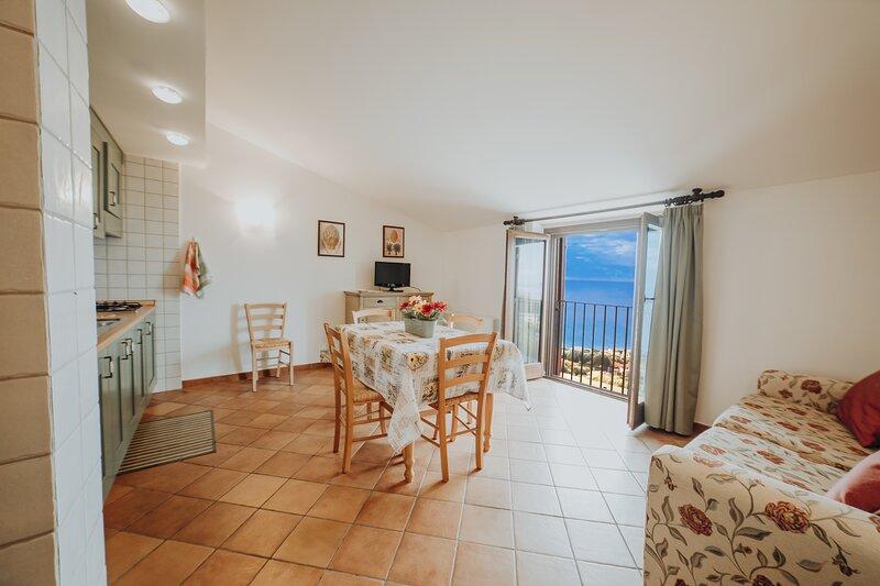 Bilocale 9 - Residenza Golfo Degli Ulivi, location de vacances à San Nicola