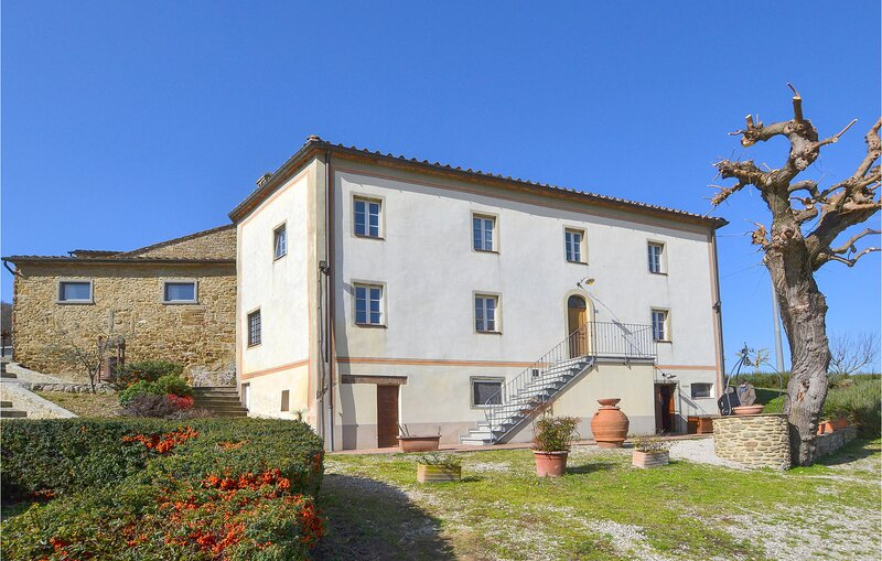 Nice home in Capolona with Outdoor swimming pool, WiFi and 8 Bedrooms (ITA071), holiday rental in Falciano