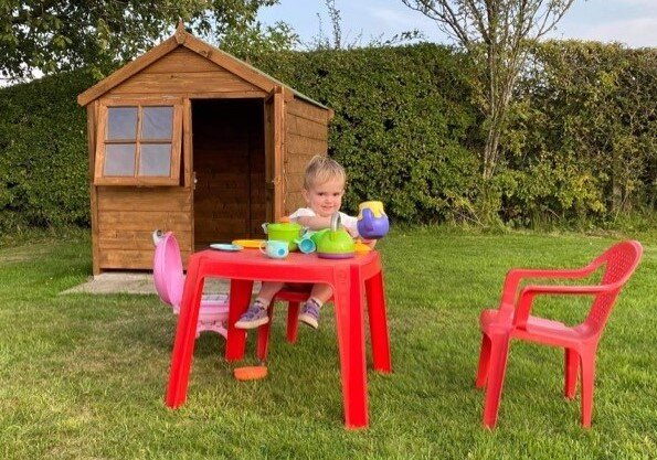 New playhouse.  Parent and carers invited for tea.
