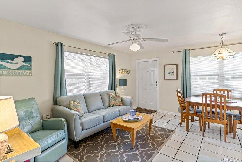 Coastal cute decor, ceiling fan for added comfort