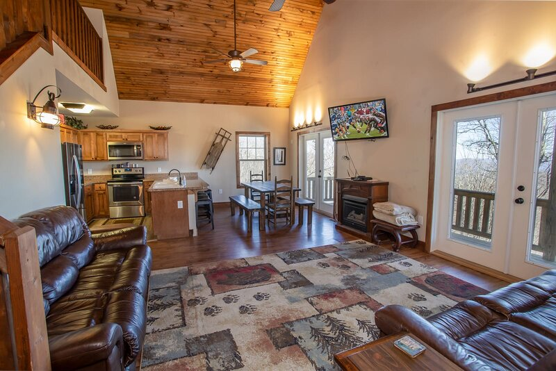 Open Concept Great Room, Kitchen, Dining with Wood Floors, Vaulted Ceilings, Fireplace, HD Smart TV