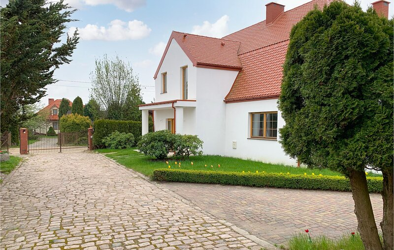 Beautiful home in Podamirowo with 5 Bedrooms (PPO748), holiday rental in Koszalin