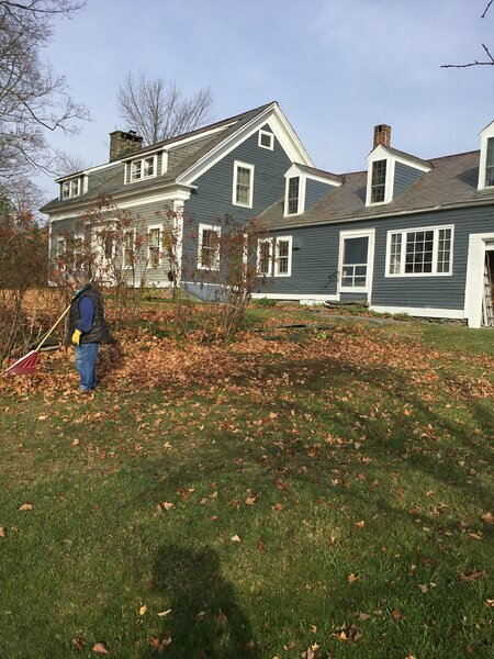 Sister raking leaves shows size of house and   just one of our big lawns. perfect playgrounds!