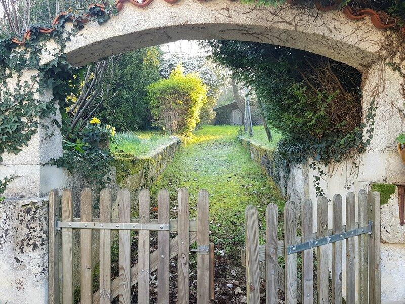 portillon donnant accès au jardin de 3500m2