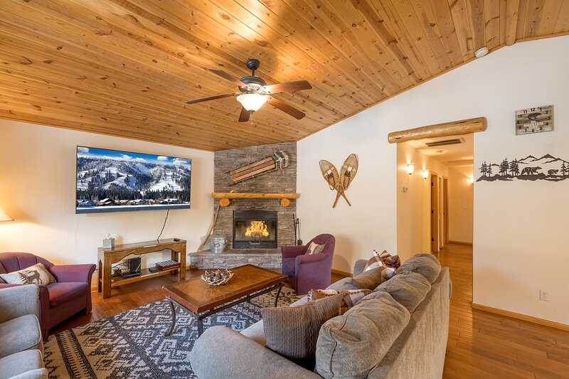 Living room with Flat Screen TV and Fireplace.