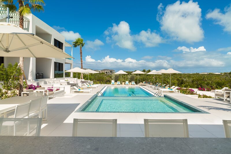 Who wants to enjoy this beautiful pool area?