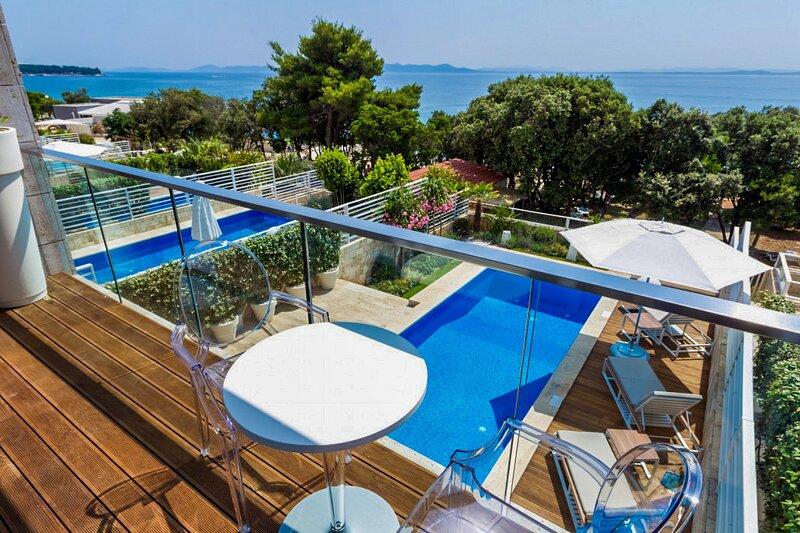 Modern Villa Magnolia, in Dalmatia, with a Pool, holiday rental in Petrcane
