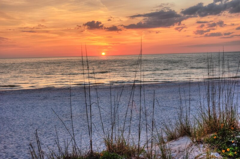 Countdown to sunset every night, just across the street at Boutique Beach Retreat.
