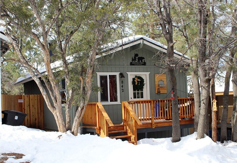 Snow covered Big Bear Cool Cabins, Dancing Pines front
