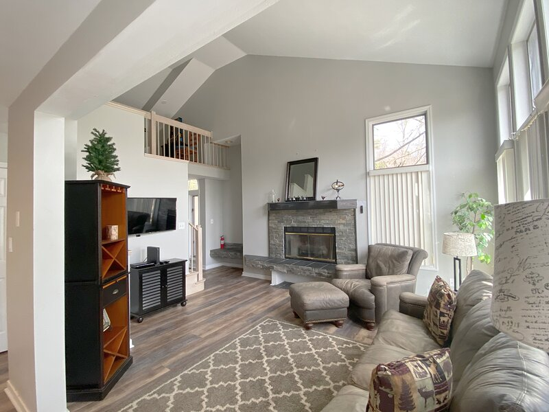 Living area with gas fireplace and flat screen tv
