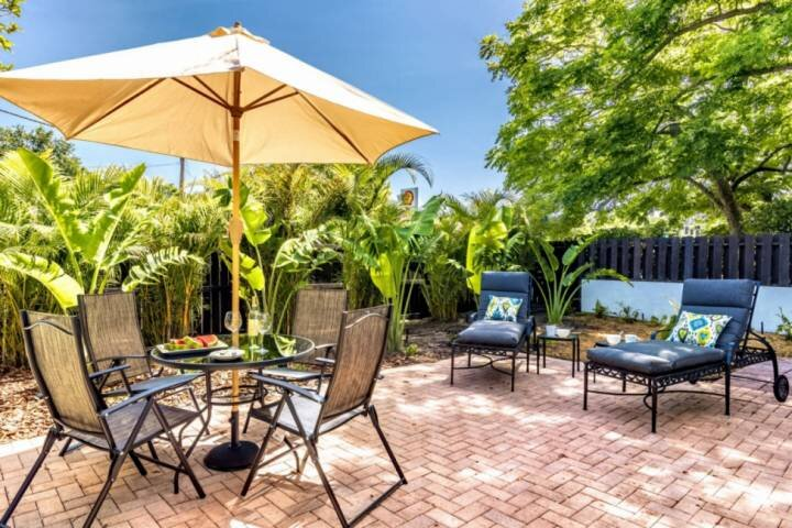 Backyard open patio with partial fencing.  Enjoy a snack or just hang out with your honey and catch some rays.