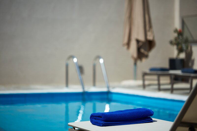 Relax and unwind at the pool sunbeds.