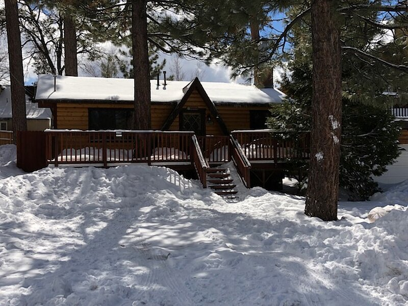 Snow covered Big Bear Cool Cabins, The Cuddle Inn front