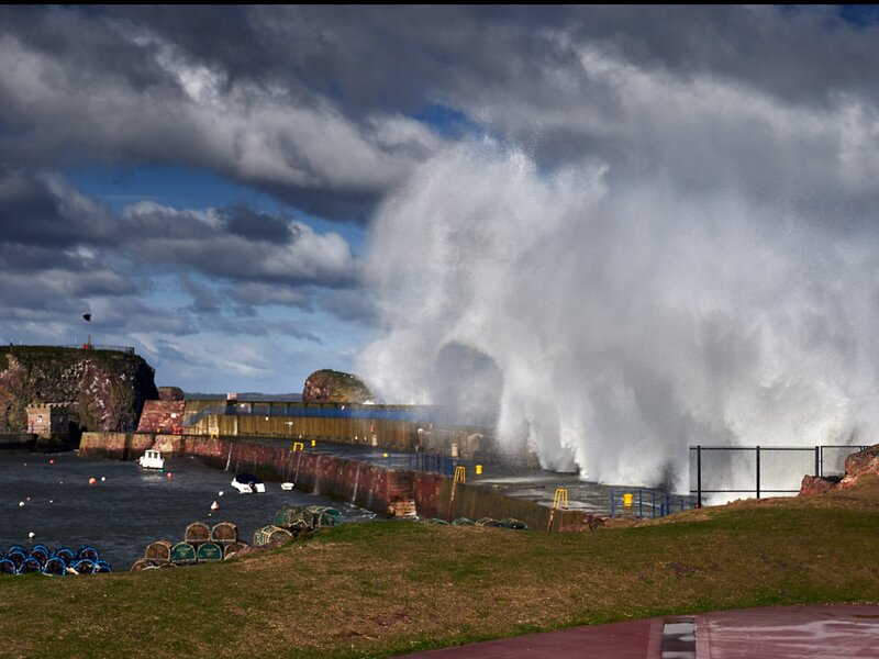 Windy day = amazing waves over the harbour wall