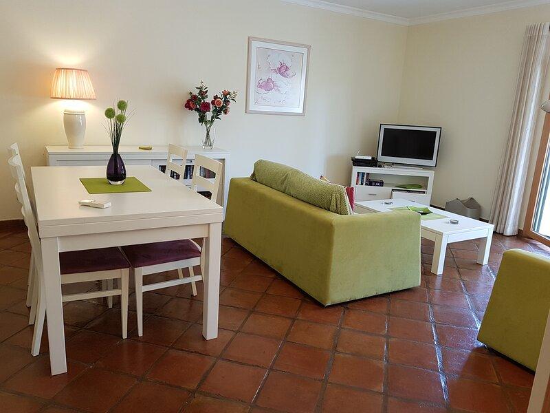 Delightful living room with doors to the veranda
