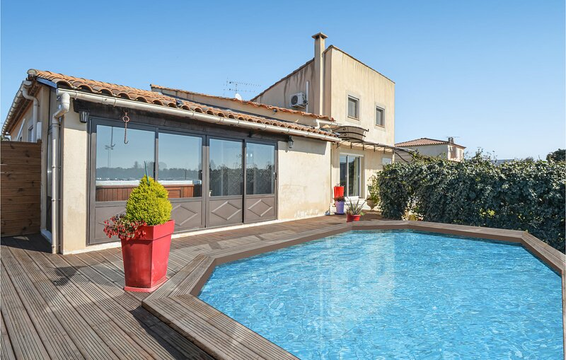 Stunning home in Arles with Outdoor swimming pool, WiFi and 2 Bedrooms (FPB430), vacation rental in Fourques
