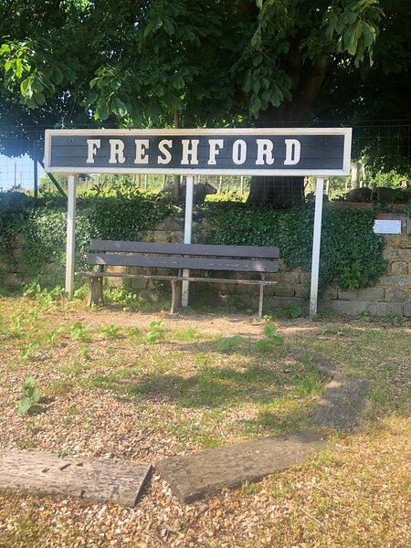 Freshford Station with sheep behind sign!
