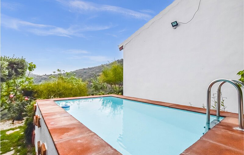 Awesome home in Málaga with Outdoor swimming pool, WiFi and 2 Bedrooms (EAC533), holiday rental in Moclinejo