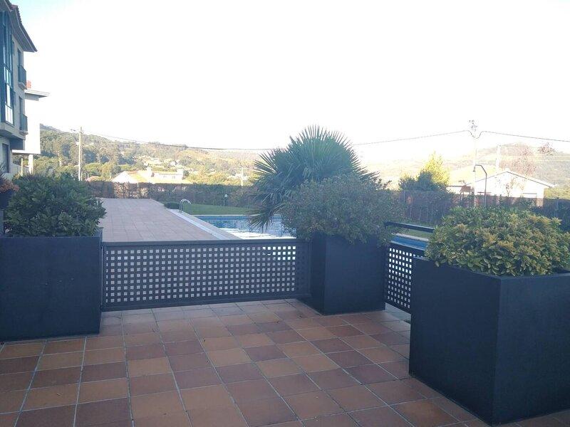 Piso de 2 habitaciones con piscina, location de vacances à A Ramallosa