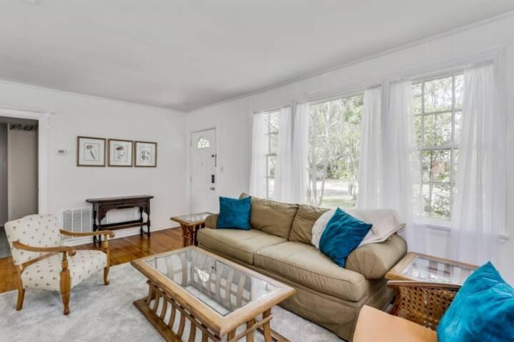Formal living room with huge windows for natural light