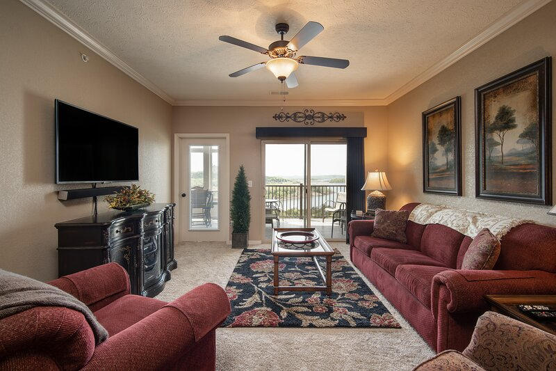 Comfortable Living Room with Cable TV/DVD, Sofa Bed, and Balcony and Sunroom Access