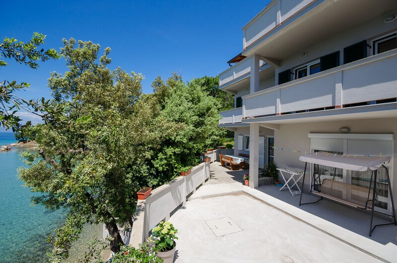 Apartments By the sea in Lopar, aluguéis de temporada em Lopar