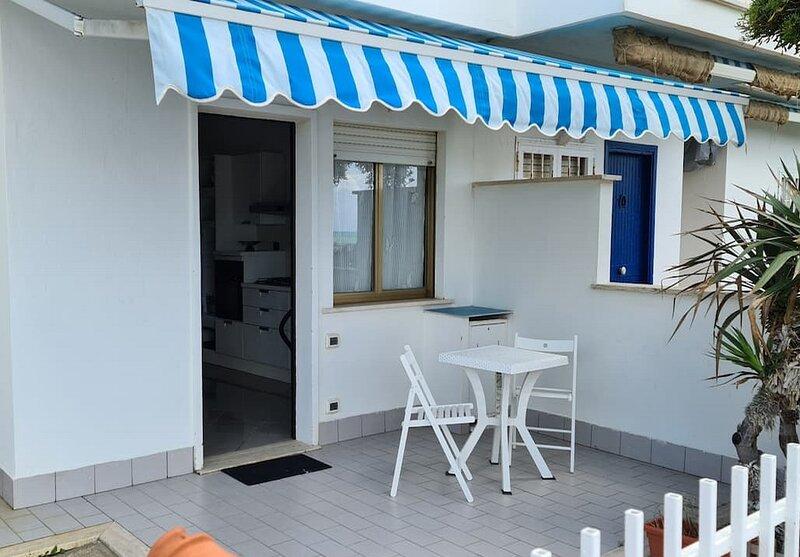 Zona pranzo esterna con tenda