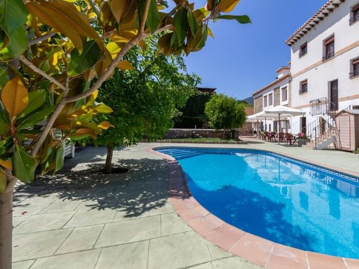 Complex of 3 apartments and 2 rural houses with swimming pool, large terrace and, vacation rental in Pinos del Valle